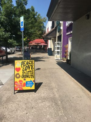 an outsider's view of what the sign looks like right outside the donut shop in old town