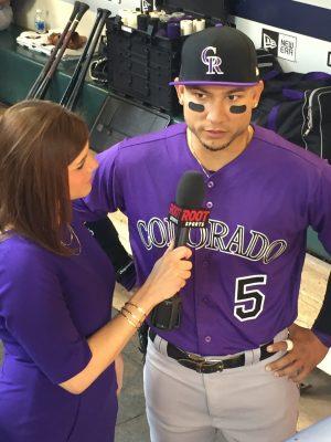 CSU Alumnus Jenny Cavnar interviews Rockies outfielder Carlos Gonzalez live on air.