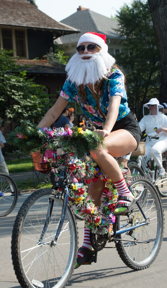 Many traditional Santa Clause's and families were found at Tour de Fat Saturday. This Santa dressed for the warm weather and kept the look tropical, yet festive. Photo by Olive Ancell | Collegian