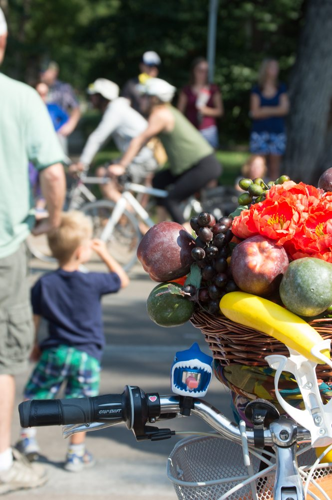Many Tour de FAt participants decorated their bikes in extravegant and colorful ways. This bike held a fruit basket, flowers, and topped off with a shark bell. Photo by Olive Ancell | Collegian