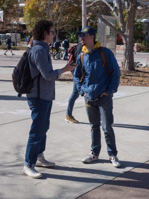 A man interviews another man