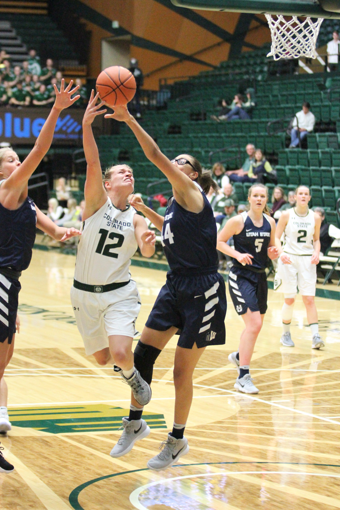 Junior Callie Kaiser goes up against two Utah State defenders Wednesday evening. CSU defeated Utah State 56-45. Photo by Olive Ancell | Collegian